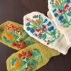 三國さんの「カバーのついた手袋」子ども用と大人用 を編みました
