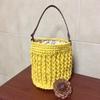 「JUTE」で編んだミニバッグ、花柄の内布をつけて春らしく。革の持ち手も付けて完成です。