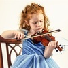 A rehearsal with little girl violinists