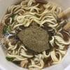 エースコック ど煮干し中華そばを食べた。 魚粉ふりかけたっぷりです。 at セブン-イレブン_池袋北口平和通り店