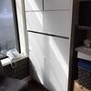 事務机兼用壁面収納什器事例