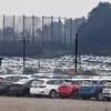 新車のBMW最大1000台が砂利と雨ざらしで保管されている件。