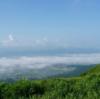 熊本地震から1年山から熊本を見つめるくまモンの写真が感慨深い